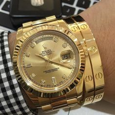 Stunning shot dripping in gold Rolex Day-Date and Cartier bracelets so hot! by wristgamers