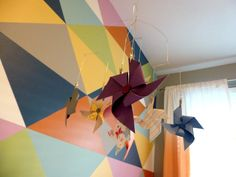 Modern Nursery with a Colorful Triangle Accent Wall and Pinwheel Mobile - Project Nursery