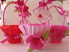 Cute little baskets: decorated paper nut cups with a crape paper streamer and pipe cleaners. Embellish with ribbons & flowers.