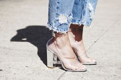 Love the clear shoes with the ragged jeans.
