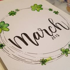 Bullet journal monthly cover page, March cover page, flower wreath drawing, hand lettering. | @dragondoodled