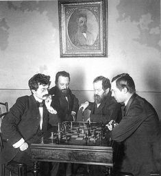 Lasker, Chigorin, Steinitz and Pillsbury examining the ramifications of the Two Knights Defense after Chigorin is also watching from the picture frame. Chess Pieces, Game Pieces, 3d Chess, Chess Sets, Paul Morphy, History Of Chess, How To Play Chess, Art Through The Ages, Chess Players