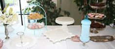 Set up of a lovely dessert table at a bridal shower that rented Southern Vintage treasures