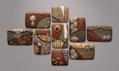 Chris Gryder Cirque Orbit #2 Ceramic panel assemblage measuring 45in high x 78in wide x 2in deep.