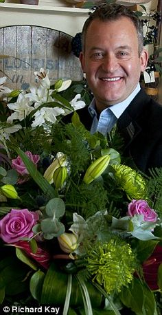 Now: Burrell poses with flowers in the Cheshire flower shop he now owns bought with money Diana left him in her will.