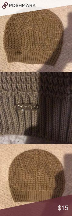Calvin Klein Knitted Beanie Hat NWOT tan colored Calvin Klein beanie hat Calvin Klein Accessories Hats