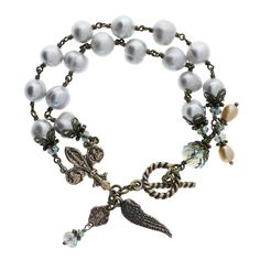 """Customer review: """"I received this bracelet as a Christmas gift from my husband and I absolutely love it! It not only is a beautiful, well made piece of jewelry but it inspires me to pray during the day. Whenever I touch a bead I remember someone in prayer, whenever I see the little wing I think of someone that needs God's help, whenever I finger the medals I remember God's mercy, Mary's motherly love, and St. Therese""""s little ways. But most of all I remember my husband and I thank God for…"""