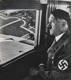 Hitler with Schaub behind him on his private plane, circa 1936.