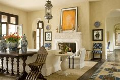 One of my favorite combinations - taupe colored walls - white furniture - blue and white porcelain accents. Never fails.