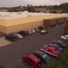 Parking lot justice!! Jeep pulls a car from its spot