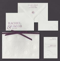 Our Zinnia invitation suite is shown here engraved in raspberry and charcoal inks.
