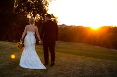 Take a walk with you new spouse! Comfortable wedding portraits, Wedding portraits on a golf course, Sunset wedding photography, golden hour wedding photo ideas