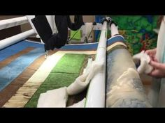 """Paola Jo shows you a FMQ """"hands on"""" way to straighten a slightly skootched border by tucking batting scraps into the quilt by the roller bars while watching . Roller Bar, Handi Quilter, Quilt Border, Thread Painting, Longarm Quilting, Quilt Tutorials, Straightener, Tuesday, Scrap"""
