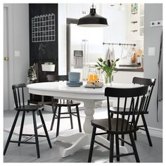 Ikea Ingatorp extendable dining table and Norraryd chairs. Table Ronde Ikea, Ikea Round Table, White Round Dining Table, Table Ikea, Large Table, Round Table With Chairs, Dining Table Design, Dining Table Chairs, Eat In Kitchen Table