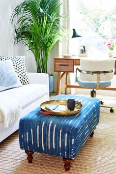 I'll need a coffee table change when the new baby starts cruising! Modern Bohemian Home Office