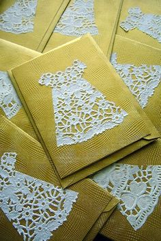 A lacy dress cut from a doily makes an adorable accent for a greeting card, tea party invitation, scrapbooking, collage, etc. What a cute idea!