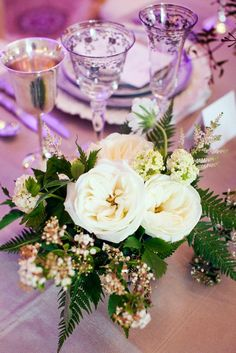 Darling little centerpiece by We + You in styled shoot by Crystal Frasier Events. Photo by Helmutwalker Photography. #wedding #centerpiece #white