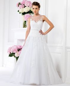 This tulle A-line gown with illusion neckline is a stunner from Jasmine's Spring 2014 collection.