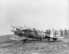 German Albatros D.V (serial number D2359/17), which was forced to land at Feuchy, being examined by British servicemen, 7 March 1918