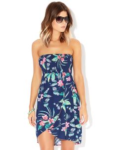 Perfect for summer holidays - this Hawaiian print dress features a bright hibiscus print decorating a navy blue base. £25, Accessorize.