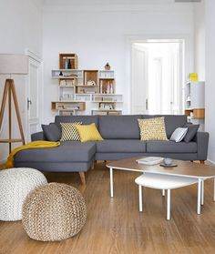 Look how prominent the yellow is, and yet it's only a few objects in a white/grey/wood room. Could change up the color every season in this way.