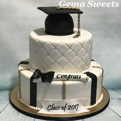 White black and gold graduation cake by Gema Sweets.