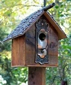 The doorknob backplate on this birdhouse is charming.