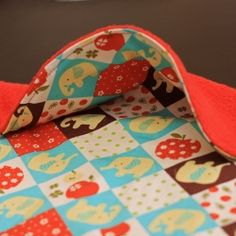 A large bib with snap up scoop to catch those crumbs. Tutorial and Pattern
