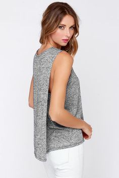 The chic, minimal design of the Dee Elle Fold Fashioned Sleeveless Blue Grey Top is Scandi style at its finest! A soft and stretchy heathered knit comes in a unique shade of navy blue-meets grey, over a sleeveless bodice with a rounded neckline. The back of the top folds in at the sides for an exciting twist! Unlined. 64% Polyester, 36% Rayon. Hand Wash Cold. Made With Love in the U.S.A.