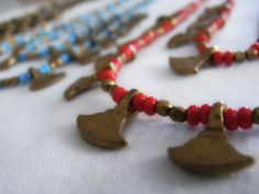 Do not miss the details! Cute handmade necklace with small axes hanging.
