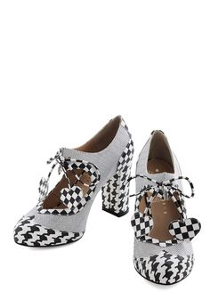 Heart Work and Dedication Heel in Houndstooth. Flaunt your proficiency for putting together powerful outfits by wearing these black-and-white pumps from Minna Parikka!Minna Parikka draws from her European travels and feminine aesthetic to create shoes meant to inspire, encourage, and empower their wearer.With their houndstooth pattern, these leather, wingtip-style shoes keep you feeling sophisticated and confident in the conference room.  #modcloth