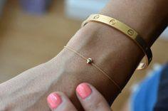 mini skull bracelet.. so cute, also love the cartier bracelet too