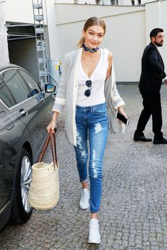 Gigi Hadid casual off duty model spring style - straw tote bag, ripped jeans, neck scarf, white tank, & sneakers