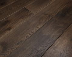 Broadleaf Dark Oak Flooring - a wood floor that is dark in tone but light in feel. The ideal choice to balance light airy interiors or create a gentleman's club feel in more traditional ones. Call 01269 851 910 for more information or visit our website.