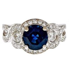 Preowned Royal Blue Round Sapphire Diamond Swirl Halo Gold Engagement... ($9,500) ❤ liked on Polyvore featuring jewelry, rings, blue, engagement rings, blue diamond rings, sapphire diamond ring, diamond engagement rings and gold diamond rings