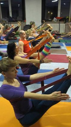 Paripurna Navasana using a strap to learn the work in the legs and upper back www.centroreserva...