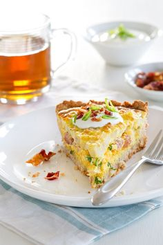 Potato Quiche is loaded with ham, potatoes, cheese and eggs making it the perfect dish for brunch. Click through for recipe!