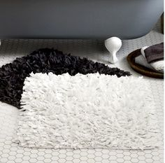 In This Bathroom You Could Either Have Black Or White Bath Mats