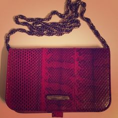 "Red Diane Von Furstenberg snakeskin WOC or Clutch Deep red DVF snakeskin purse/clutch with removable chain link strap.  Wallet on a chain style.  Excellent used condition, no flaws to mention.  20"" length brassy gold chain link removable strap.  No trades and reasonable offers only please. Diane von Furstenberg Bags Clutches & Wristlets"