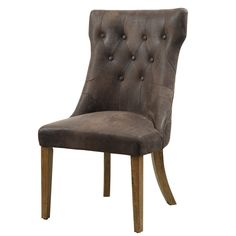 Elegant and stately, this Parkins side chair will elevate the sophistication in your dining room. The crest style silhouette of the chair complements its comfortable brown vinyl upholstery with button tufting.