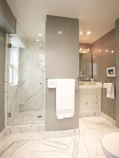 Gray Sophistication ll Marble takes an ordinary bathroom from bland to brilliant by bouncing the light around to make even a small bathroom feel much brighter and more spacious. Contractor Stephen Fanuka of Million Dollar Contractor uses oversized marble tiles on the floor and in the shower to create this lavish bathroom as seen on HGTV.com. #Interiors #Decor #Grey fairylights.com