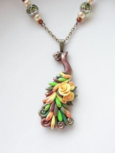 Peacock necklace handmade from polymer clay in yellow, green and copper by fizzyclaret