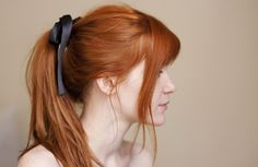 """Gorgeous ginger locks and black bows = love. Photo of Flickr's """"See Creatures"""", aka Catherine Parkinson."""