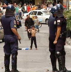 The picture originally comes from photographer Evandro Monteiro, and was taken during a police action in Sao Paulo, Brazil. And while we look at an image like this and recognize what it inspires in us all, . Make Funny Faces, Incredible Hulk, Amazing, Children Images, Funny Kids, Just In Case, Funny Pictures, How Are You Feeling, Street Photography