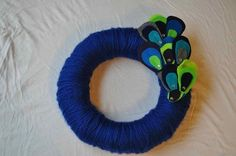 peacock yarn wreath! #yarn #wreath #peacock diy-wreaths..... cute for front door. Replace felt for real feathers?