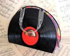 Custom Made Upcycled Vinyl Record Purse w/ Vintage Fabric Lining and Lucite Handles. via Etsy.