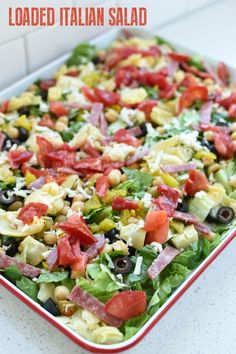 Loaded Italian Salad is a perfect addition to an Italian family dinner. Add home… Loaded Italian Salad is a perfect addition to an Italian family dinner. Add homemade copycat Olive Garden Italian salad dressing to make it even better. Italian Salad Recipes, Best Salad Recipes, Salad Dressing Recipes, Healthy Recipes, Salad Dressings, Italian Chopped Salad, Olive Salad Recipe Italian, Lettuce Salad Recipes, Chopped Salads