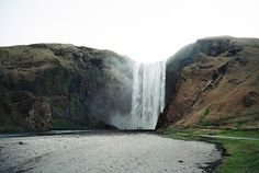 ICELAND – Skógafoss waterfall, Skógá River, Southern Region. At the Skógafoss car park from the village of Skógar there is a hiking trail that goes up to the falls. The falls are located 0.8 kilometre (0.5 mile) from the village of Skógar. https://www.goo https://www.worldtrip-blog.com