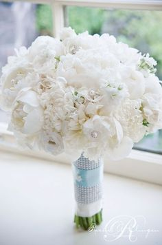 This glamorous bouquet creates a statement with crystal pins studding the arrangment of peonies and hydrangeas.