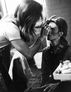 Make-up artist Pierre La Roche prepares David Bowie for a performance as Aladdin Sane - 1973